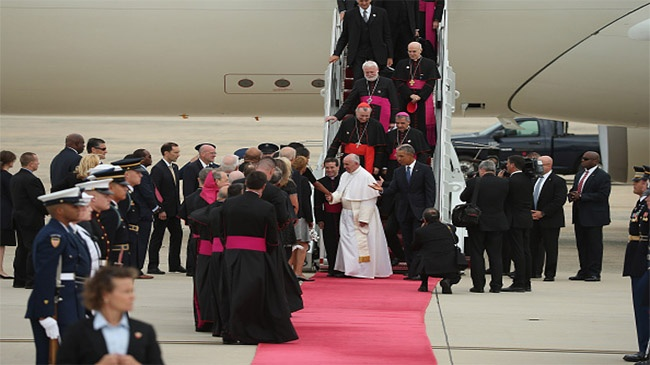 Local community members traveling to see Pope Francis