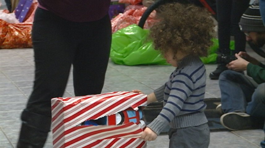 Racing team surprises families with early Christmas gifts