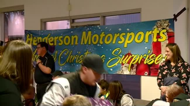 Local racing team donates gifts to area families