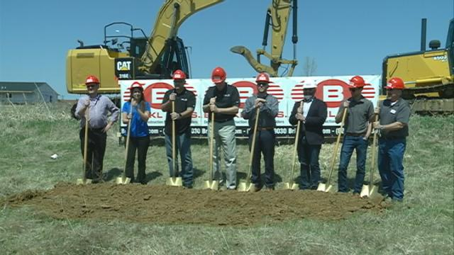 Ground was broken Friday in West Salem on a new repair facility for large mining equipment