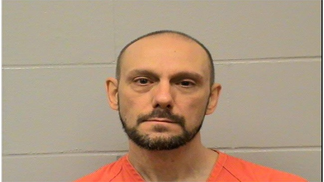Man pleads guilty after trying to stab officers