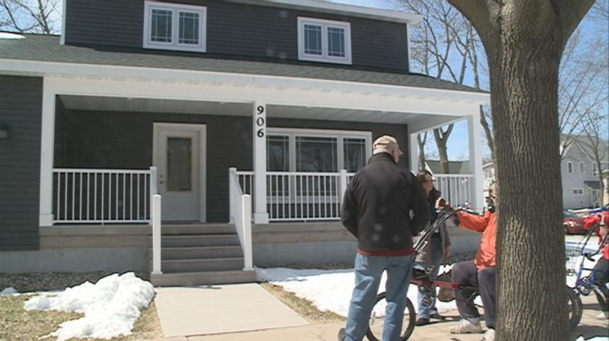 Home owners take possession of home thanks to La Crosse program