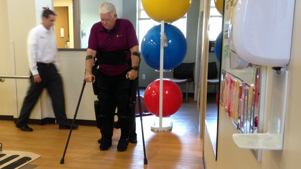 Paralyzed man walks with device that's first of its kind in state
