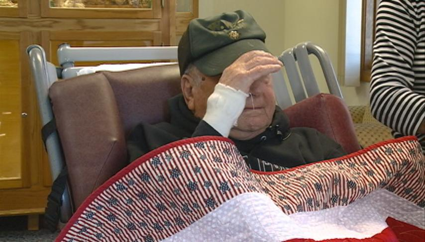 World War II veteran honored with quilt of valor