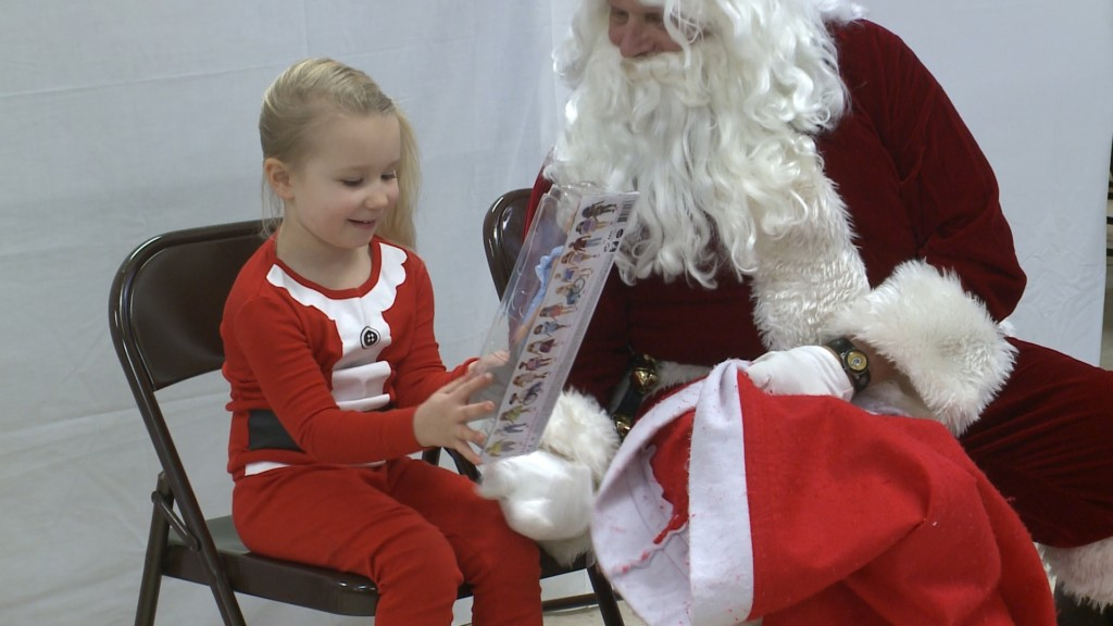 Santa hands out gifts at local community center