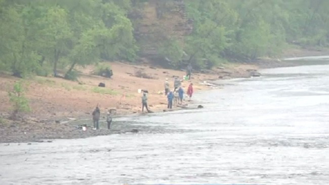 Officials ID 21-year-old whose body was pulled from river