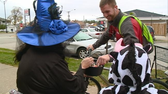 Senior citizens hand out candy to La Crosse college students