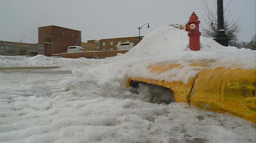 Clearing snow from storm drains may help reduce street flooding