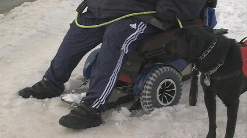 Local residents with disabilities have hard time getting around sidewalks in the snow