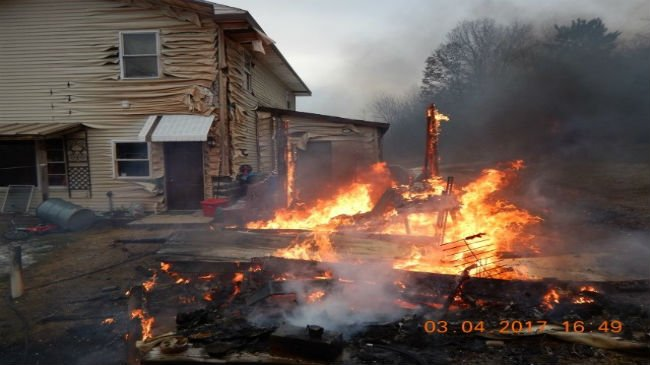 Jackson County fire destroys shed, damages home