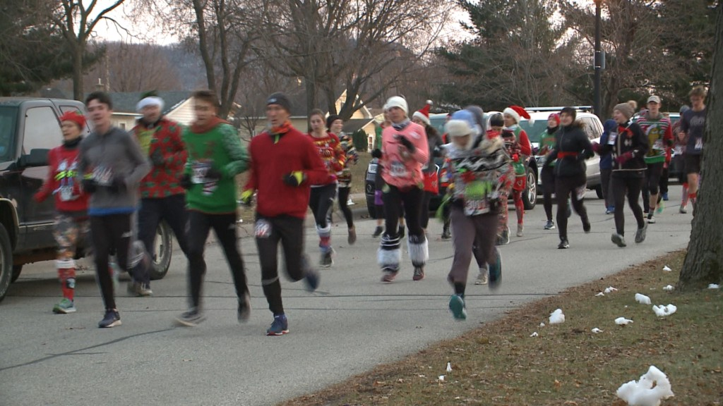 People dressed in ugly sweaters for annual fun run