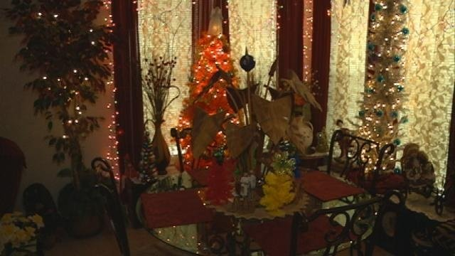 Area woman collects more than 50 Christmas trees
