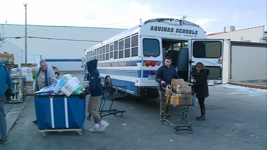 Aquinas students 'stuff the bus' to benefit WAFER
