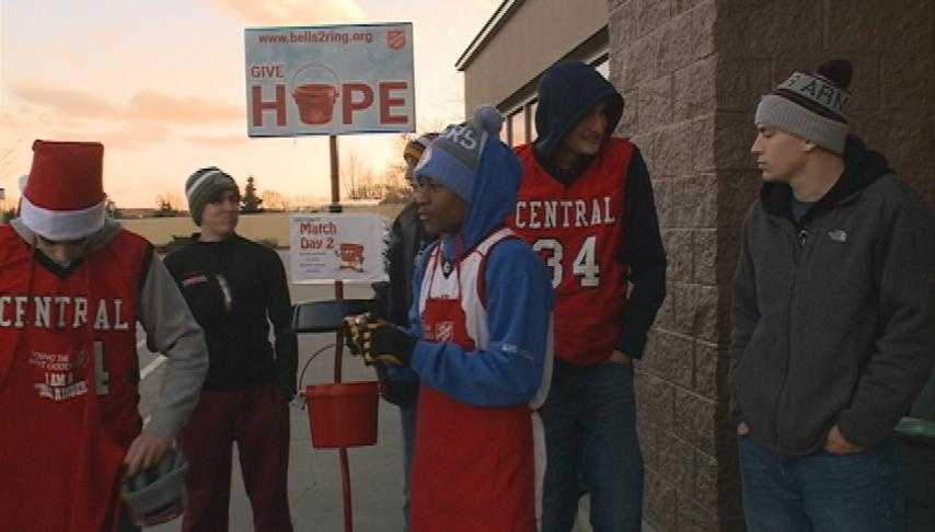 Central basketball players ring bells for Salvation Army