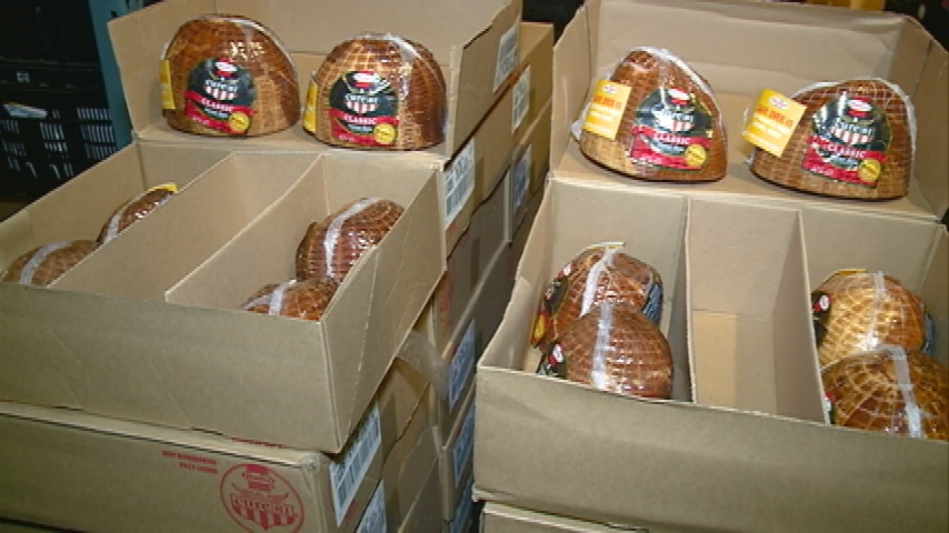 Festival Foods donates nearly 200 hams to Hunger Task Force