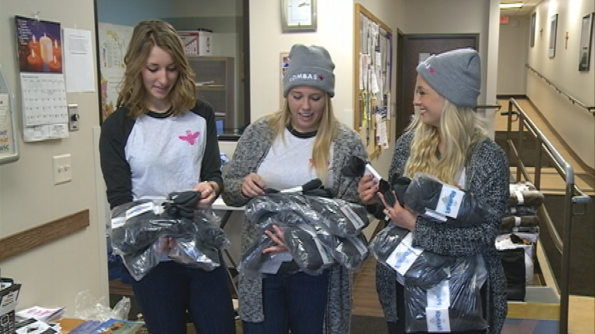 UWL students donate socks to warming center