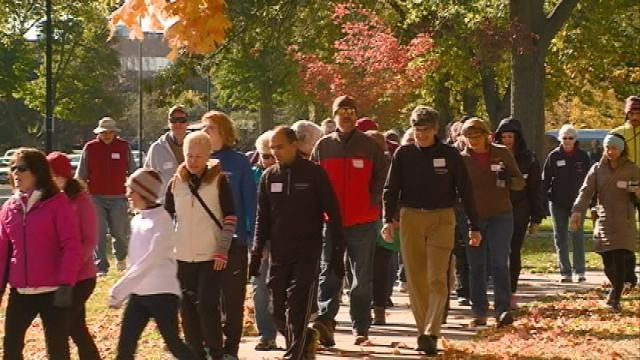 "Dozens show up to ""Walk With A Doc"" at Riverside Park"