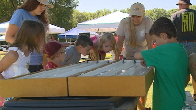 Kids try log rolling and throwing hatchets at Youth Outdoor Fest in La Crosse