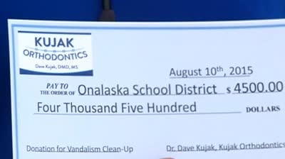 Donation helps clean up vandalism at local elementary school