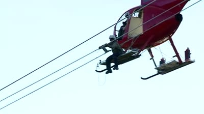 Xcel uses helicopter crews to work on power lines