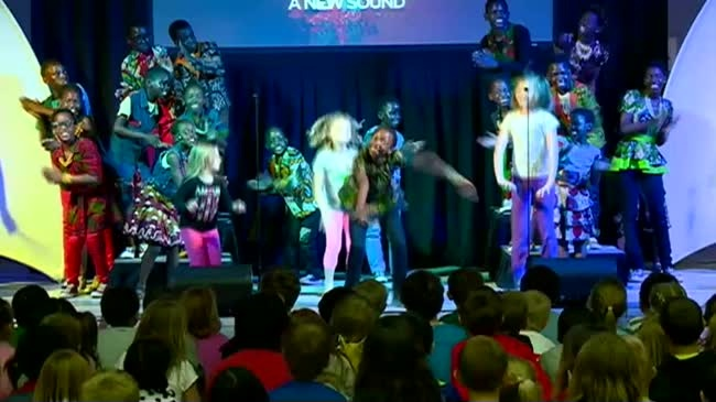 African choir teaches La Crosse students through song and dance