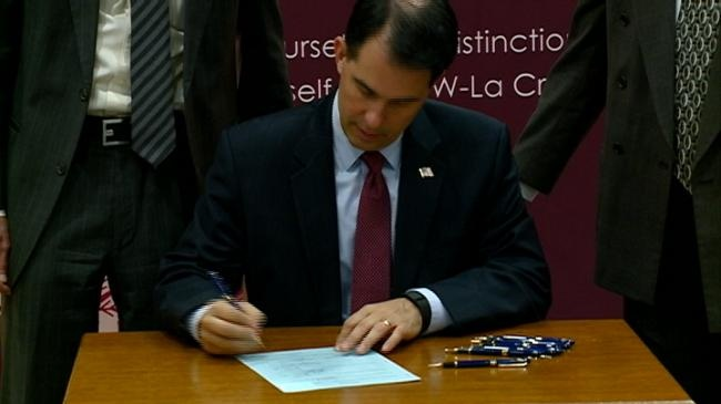 Walker signs college affordability bill at UW-La Crosse