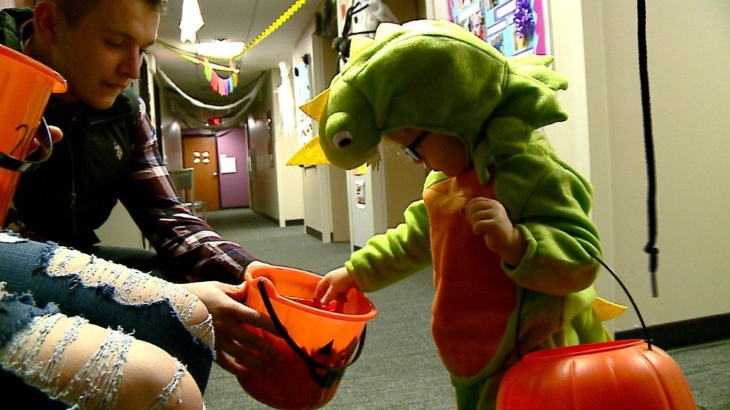 Trick-or-treaters visit local college
