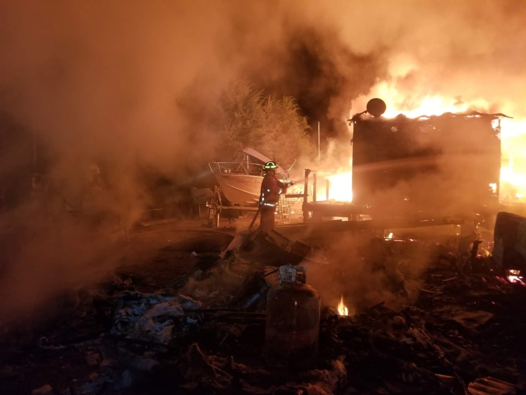 Home, several vehicles destroyed in early morning fire