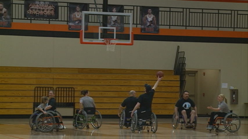 Wheelchair basketball game benefits organization for people with disabilities