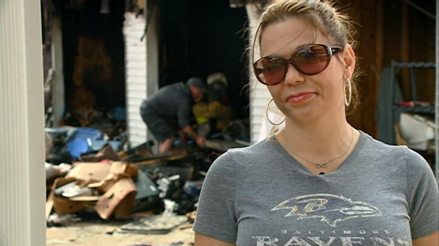 People pick up the pieces after a fire destroys storage units