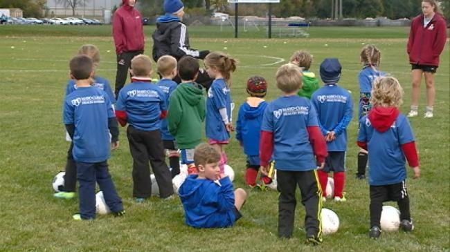 Local soccer academy pairs kids with college players