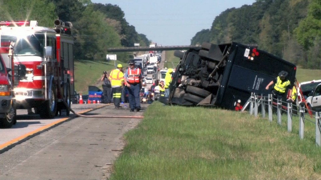 Bus bound for the Masters overturns, driver charged with DUI