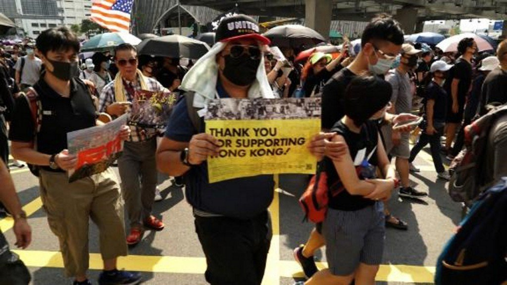 Protesters celebrate after Trump signs Hong Kong human rights act