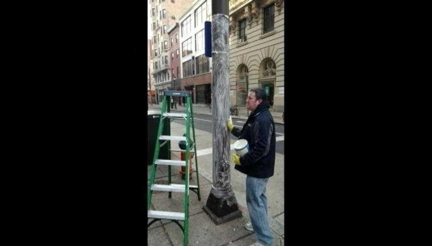 Philadelphia greasing light poles to stop fans from climbing