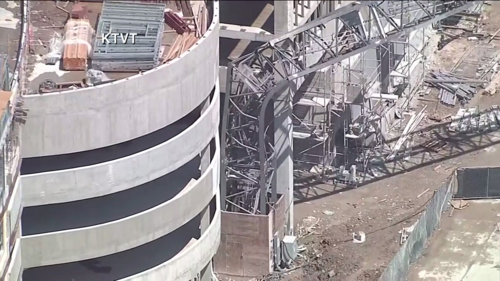 At least 1 person dead after crane falls on Dallas apartment building