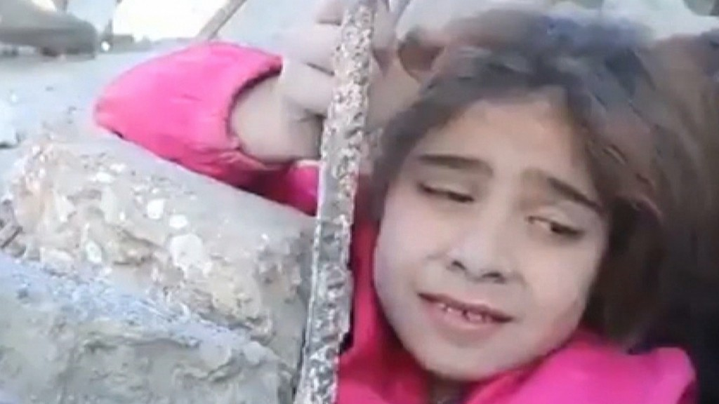 Dramatic video shows Syrian girl being rescued in middle of airstrike