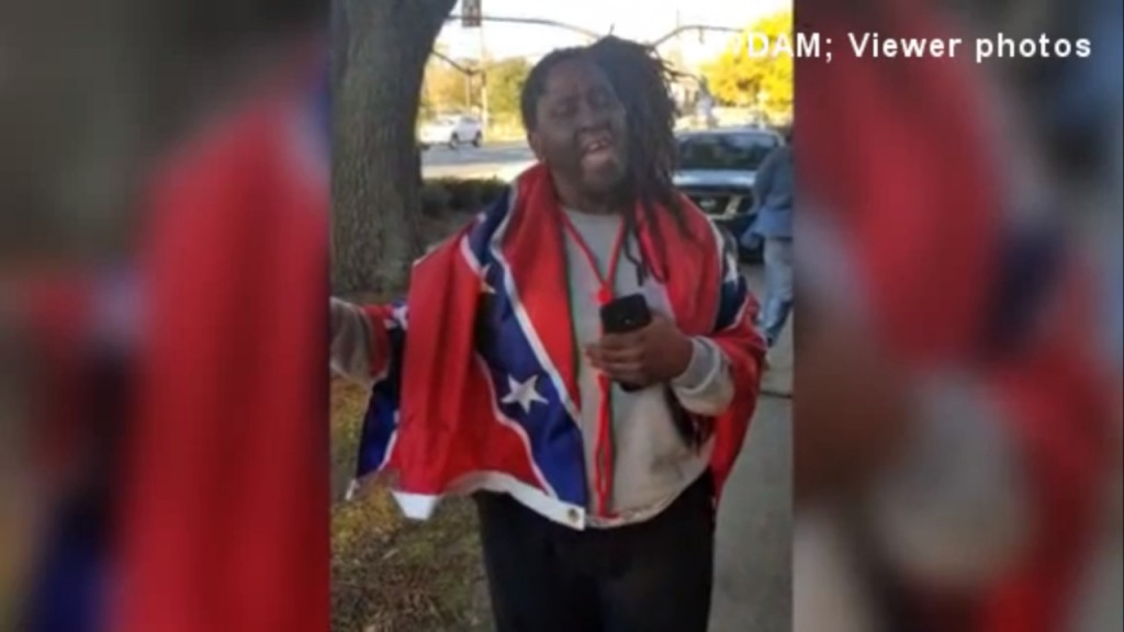 Mississippi woman wears Confederate flag to polls to make point