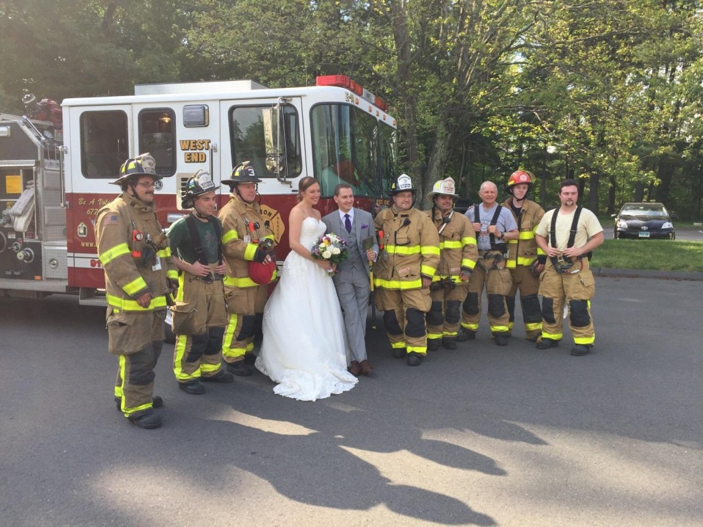 Firefighters save the day … by taking newlyweds to their reception