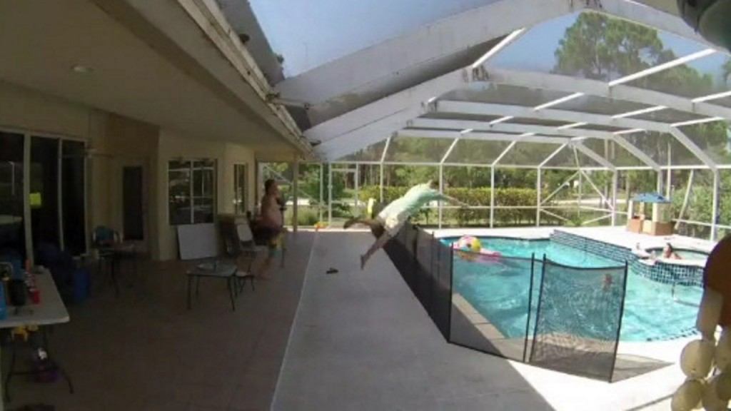 Dad leaps over 4-foot fence to save son from drowning