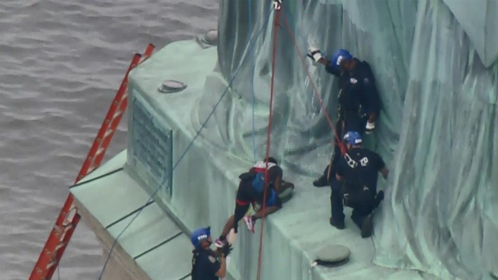 Statue of Liberty protester charged for 'dangerous stunt'