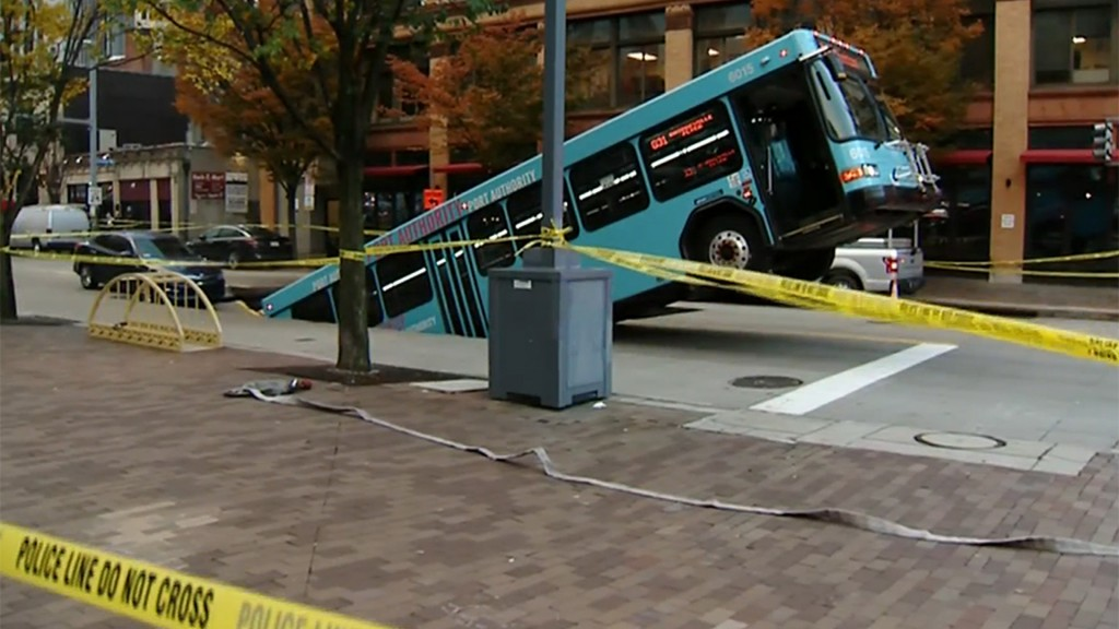 City bus falls into sinkhole in Pittsburgh
