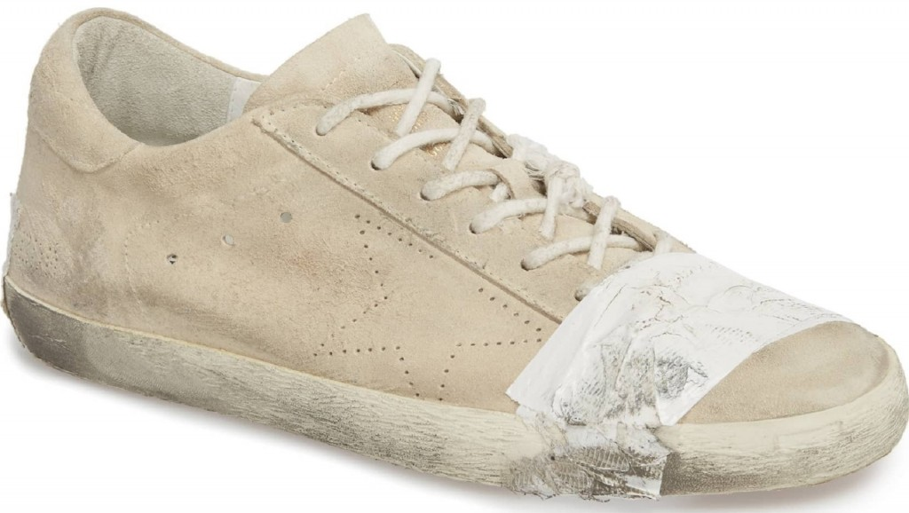 Grungy, taped-up designer sneakers sell for $530