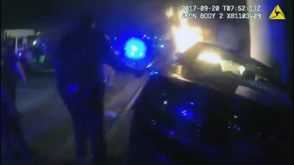 Police body cam video shows rescue from life-threatening car fire