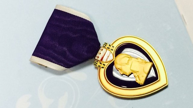 Contractor finds purple heart in rubble of Wisconsin house