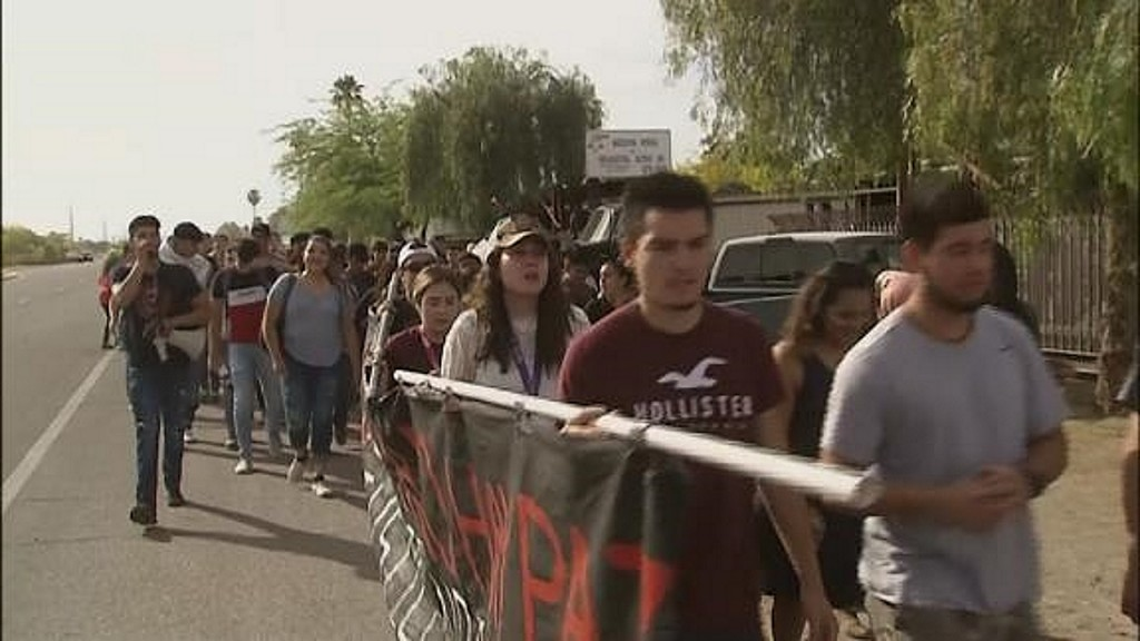 Students walk out after a classmate turned over to border agents