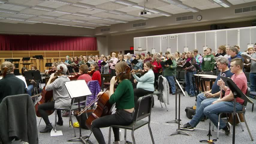 Local singers and musicians prepare for an upcoming performance