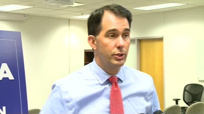 The Latest: Walker attacks Madison, while also promoting it
