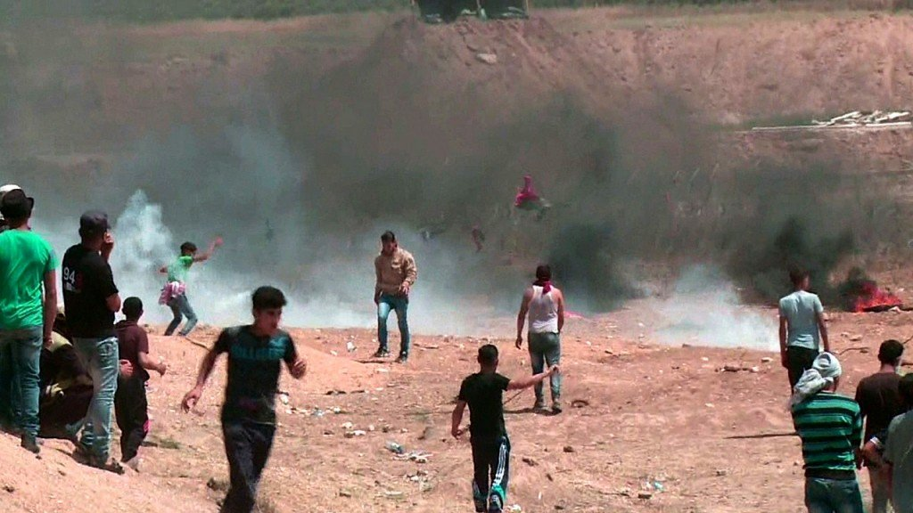 Israel defends Gaza crackdown as Palestinians bury their dead
