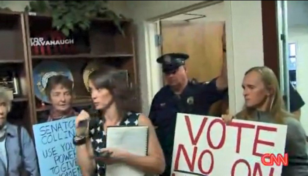 Protesters clash outside of swing vote senator offices