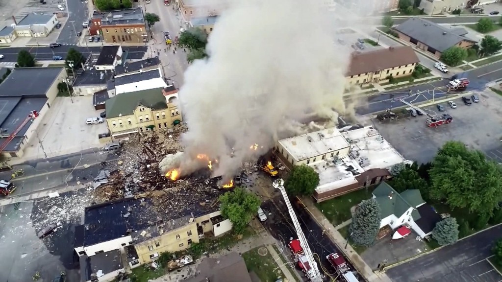 Firefighter dies after gas explosion turns street into rubble